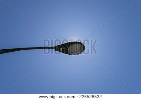 Shot Looking Up On A Street Lamp During Daytime.