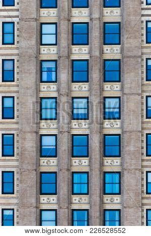Shot Of A Nameless Building With Blue Windows.