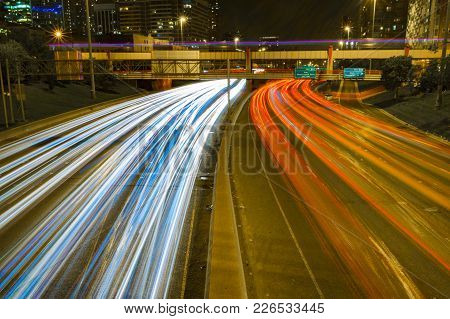 Long Exposure Shot Of A Highway Passing Through Downtown Chicago, Illinois.