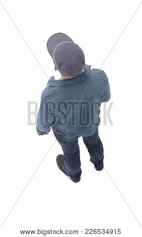 view from above. guy in a baseball cap and denim jacket