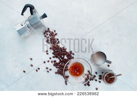 Pouring Coffee Beans From Moka Pot In A Glass Espresso Cup With A Saucer. Creative Top View Hot Drin