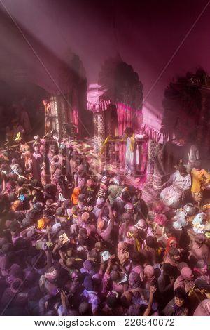 Vrindavan, India - March 23, 2016: Holi celebration in the Hindu Banke Bihare temple in Vrindavan, Uttar Pradesh, India.