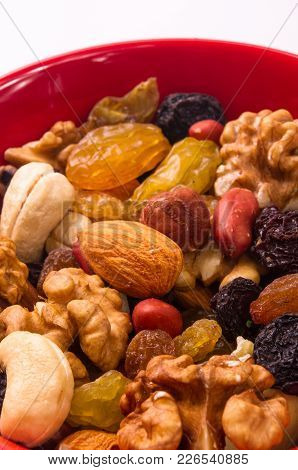 Various Different Mixed Nuts And Raisins On White Background