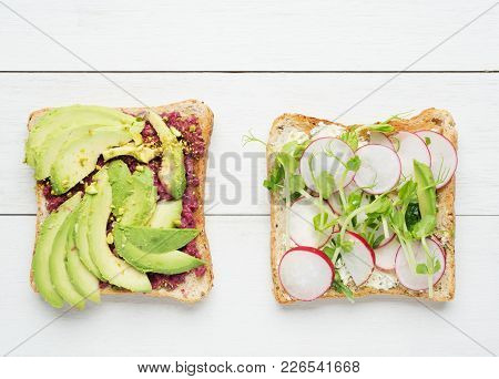 Two Avocado Toasts With Mashed Avocado And Beetroot,sliced Avocado ,radish, Snow Pea Sprouts And Goa