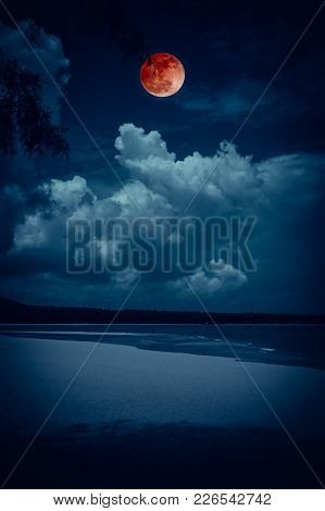 Beautiful Landscape View On Seascape To Night. Attractive Red Full Moon Or Blood Moon On Dark Blue S