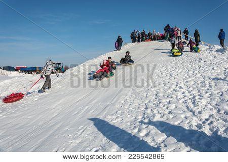 Skating From A Snow Slide At The Festival Winter Fun In Uglich, 10.02.2018 In Uglich, Yaroslavl Regi