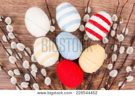 Easter Catkins And Eggs Wrapped Woolen String On Rustic Board, Festive Decoration Concept