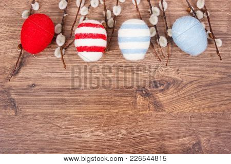 Colorful Eggs Wrapped Woolen String And Easter Catkins As Festive Decoration On Rustic Board, Copy S