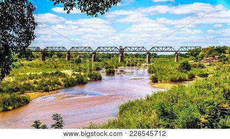Railway Truss Bridge Over The Sabie River At Skukuza Rest Camp In Kruger National Park In South Afri