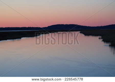 Sunset On A River In Massachusetts In The Middle  Of Winter Time.