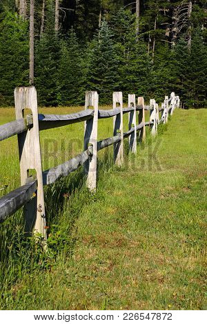 A Wooden Post Fence In A Summer Field In The White  Mountains.