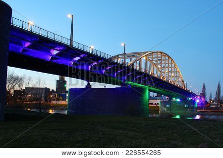 Arnhem, The Netherlands - March 25, 2017: John Frost Bridge In Arnhem During Blue Hour With Colorful