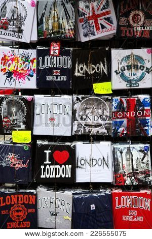 LONDON, UK - JUNE 5 , 2017: Different t-shirts for sale in a tourist store with union jack, name of the city etc.  Great souvenirs of London, UK.