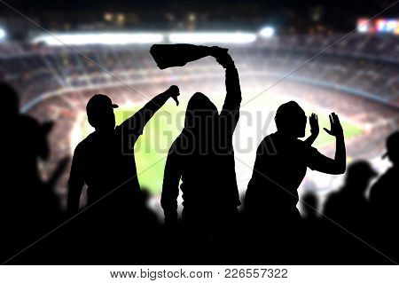 Football Hooligans In Game. Angry Soccer Fans Shouting And Booing In The Crowd. Losing Team Fans Got