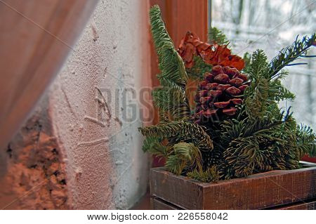 Concept Cozy Winter Evening. Still Life: Coniferous Branches And Pine Cone Against  Background An Ol