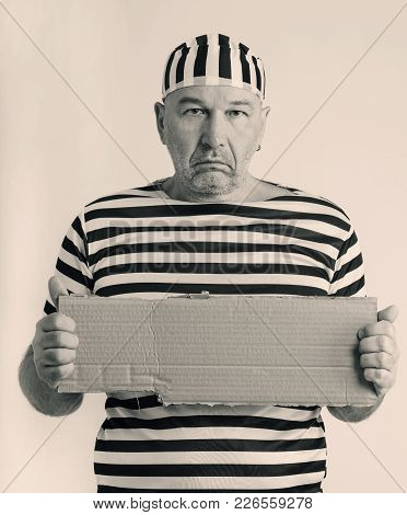 Portrait Of A Man Prisoner In Prison Garb In Retro Style