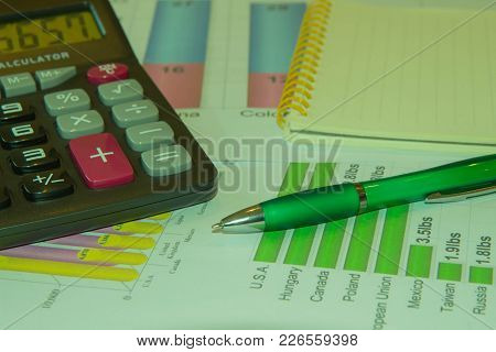 Analyzing Financial Data And Counting On Calculator. Sales Earning Chart