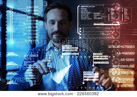 Amazing Program. Smart Software Specialist Standing In Front Of A Transparent Screen Of His Modern D