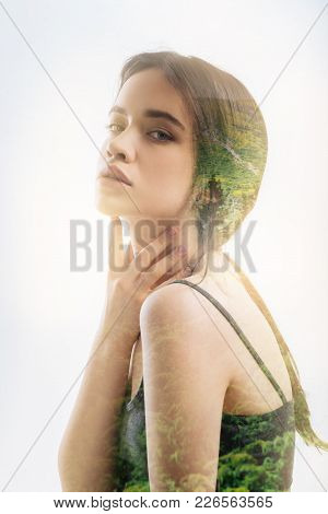 Round Shouldered. Calm Young Beautiful Woman Sitting Round Shouldered And Touching Her Neck While Th