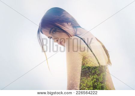 Calmness. Pretty Serious Young Woman Standing Round Shouldered And Feeling Calm While Looking Into T