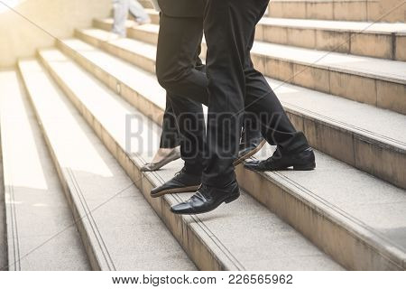 Group Of Business Person Walking On Stairs. Rush Hour Concept