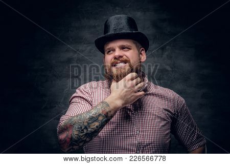 Bearded Male With Tattooed Arms Wearing Top Hat.