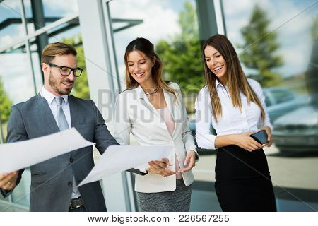 Picture Of Business People Discussing In Their Company Together
