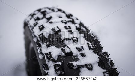 Close Up Shot Of The Tread On A Fat Mountain Bike Tire In Snow.