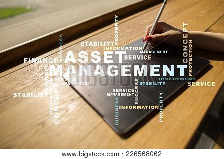 Asset Management On The Virtual Screen. Business Concept. Words Cloud