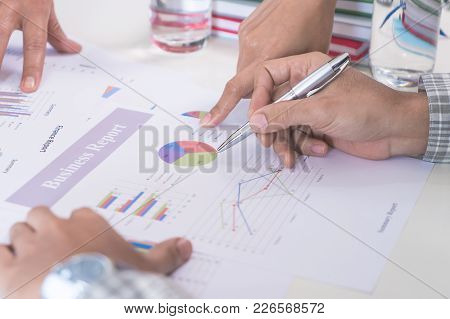 Casual Business Man Writing On Businss Report
