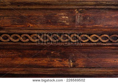 Vintage Background. Elements Of An Old Carved Wooden Door Decorated With Voluminous Carved Wooden El