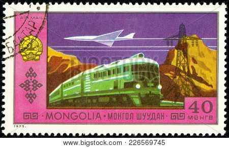 Ukraine - Circa 2018: A Postage Stamp Printed In Mongolia Show Airplane And Train. Series: National