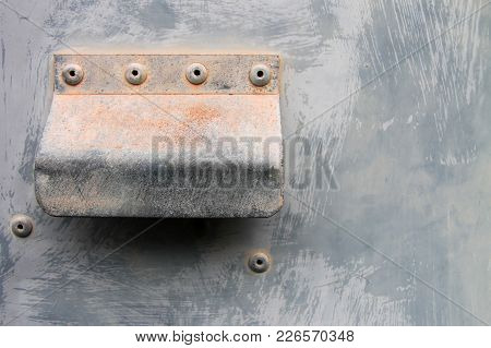 Rusty Metallic Handle With Several Old Screws