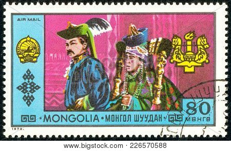 Ukraine - Circa 2018: A Postage Stamp Printed In Mongolia Show A Man And A Woman In A Traditional Mo