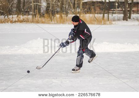 Dnipro, Ukraine - January 27, 2018: Mature Amateur Men Playing Hockey On A Frozen River Dnepr In Ukr
