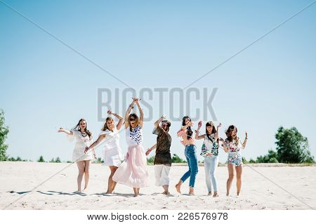 Beautiful Stylish Happy Sexy Slim Young Girls Danssing On Sand Beach. Party In Style Boho. Maiden Ev