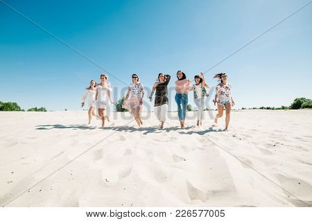 Beautiful Stylish Happy Sexy Slim Young Girls Running On Sand Beach. Party In Style Boho. Maiden Eve