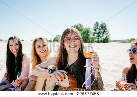 Beautiful Happy Slim Stylish Sexy Young Girls Sitting Sand Beach Drink Champagne Play Guitar. Hand D
