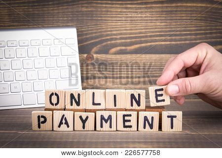 Online Payment. Wooden Letters On The Office Desk, Informative And Communication Background.