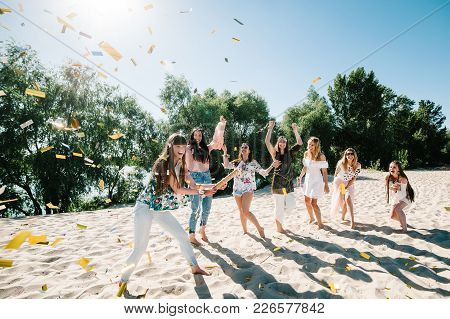 Beautiful Happy Stylish Sexy Young Girls Go Runs Stand In Beach Opens Throwing Colored Confetti On B