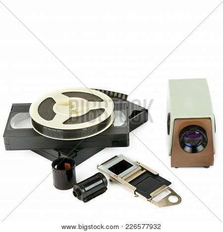 Old Videocassettes And Video Projector With Slides Isolated On White Background. Free Space For Text