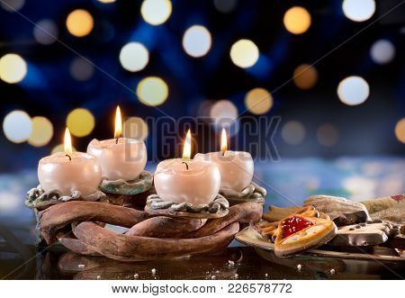 Advent Wreath With Burning Candles On The Dark Background