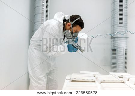 Painter Using Airbrush To Paint Wearing Protective Safe Clothing
