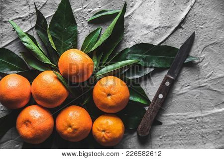 Citrus On Table: Mandarin, Tangerine With A Knife. Fresh Organic Juicy Fruits. A