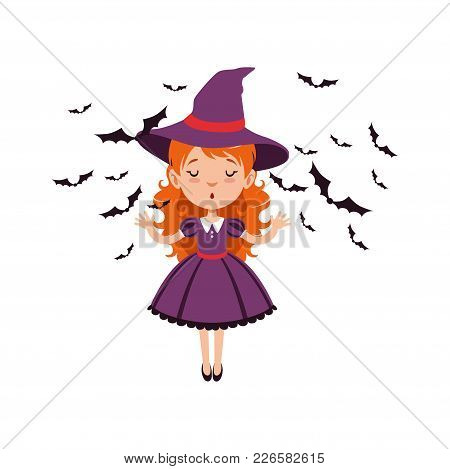 Young Red-haired Girl Witch Standing With Hands Up And Wearing Purple Dress And Hat. Kid Character I