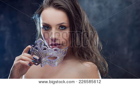 Mysterious And Beautiful Brunette With Venetian Mask. Carnival