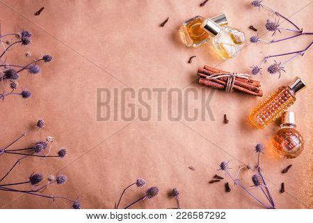 Bottles Of Perfume With Ingredients On Paper