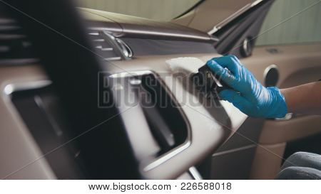 Worker Female In Gloves Is Washing With Brush A Car Interior, Close Up View