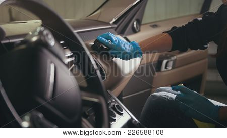 Worker In Gloves Is Washing With Brush A Car Dashboard, Close Up
