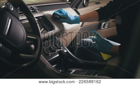 Worker In Gloves Is Washing With Brush A Car Interior And Seats, Close Up